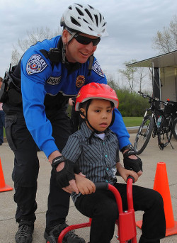 Policeman Volunteering | Bauer Family Resources